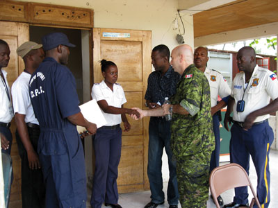 p26_Comd-greets-authorities